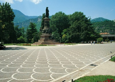Porphyry cubes peacok tail - Dante square Trento Italy