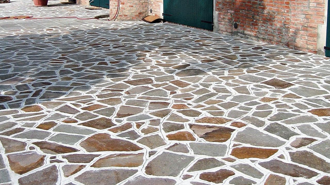 Lastre irregolari lastrame in porfido pavimentazioni - Vialetti giardino in porfido ...