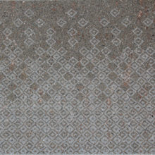 Installation of the Arlecchino texture on a flamed surface.